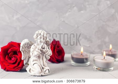 Mourning  Postcard. Little Angel, Red Roses And Burning Candles On Grey Textured Background. Card Fo