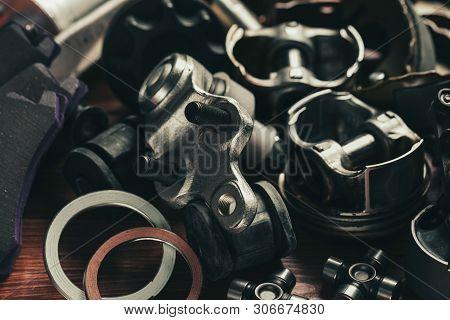 Various Car Parts On Dark Woooden Background