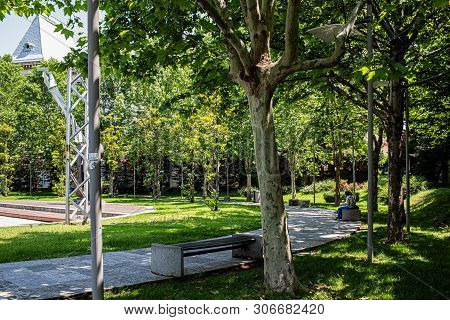 Bucharest, Romania - May 30, 2019: Women eating outside on a bench in Coltea Park  near the University Square.