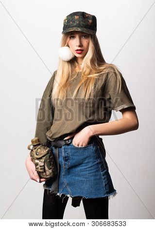 Magnificent White Girl In Military Clothes Posing With Flask. Studio Portrait Of Beautiful Lady In J