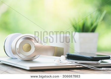 Close Up Headphone Device On Desk Green Nature Backgroud