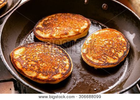 Cooking Pancakes In A Pan With Butter As Delicious Breakfast Meal For A Happy Family