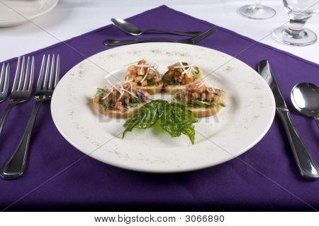 Bruschetta At A Table Setting