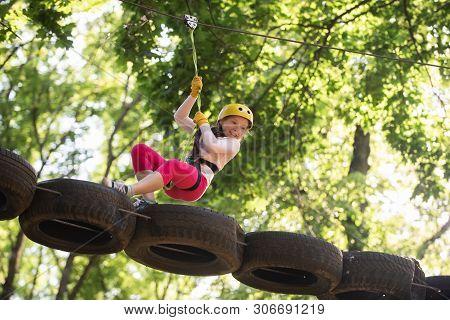 Eco Resort Activities. Climber Little Girl On Training. Children Fun. Rope Park. Active Children. Pl