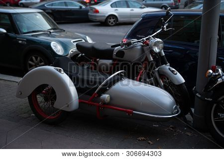 Motorcycle With A Sidecar Parked On The Sidewalk To The Post. Berlin, Germany. February 19, 2019.