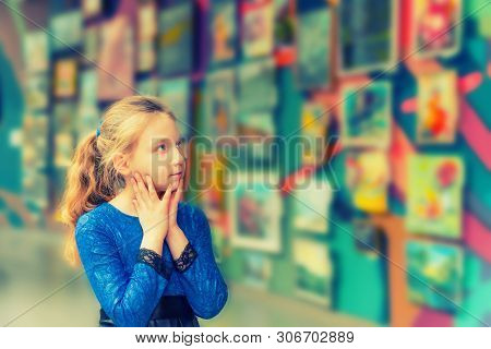 The Girl In The Art Gallery Looks At Works Of Art And Admires The Works Of Great Masters Of Art.