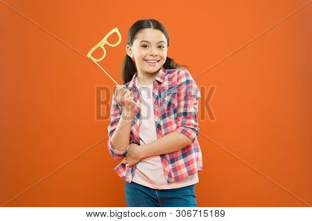 My Party Photo Booth. Cheerful Party Girl On Orange Background. Adorable Little Child Holding Party