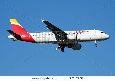 Iberia Airlines Airbus A320 Ec-ils Passenger Plane Landing At Madrid Barajas Airport