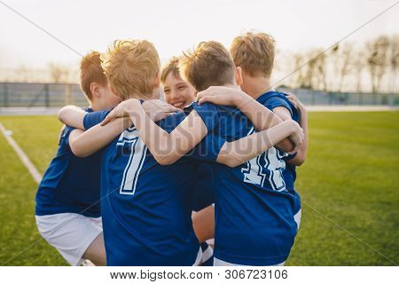 Happy Kids In School Sports Team. Boys Gathering And Having Fun On Sports Field. Cheerful Children B