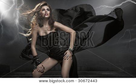 Gorgeous woman wearing black dress