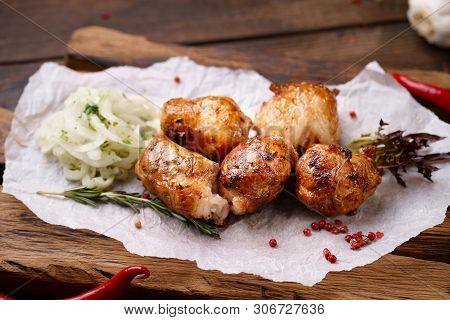 Grill Bar, Tasty Chicken Meat. Shish Kebab With Marinated Onions Garnishing On Wooden Board. Summer