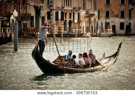VENICE - MAY 27: Gondola in canal on May 27, 2016 in Venice, Italy. Gondola is the symbolic tourism activities and part of the culture in Venice.