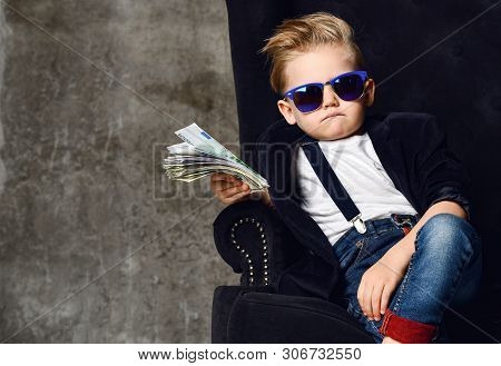 Happy And Shoutting Arrogant Rich Kid Boy Millionaire Sits With A Bundle Of Money Dollars Cash In Bi
