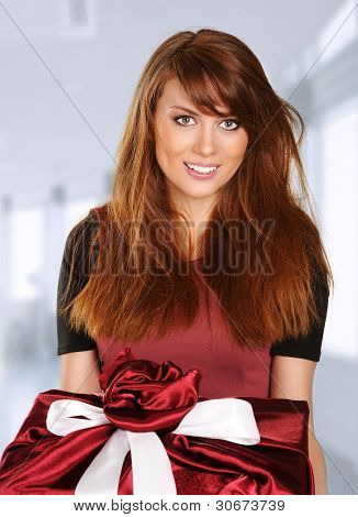 Young Woman With A Red Gift Box