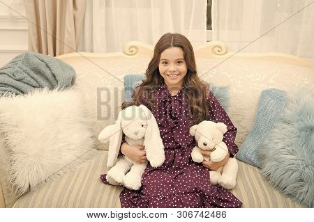 little child girl wait for smas present. The morning before Xmas. Home interior. happy new year. Sweet home. waiting for santa. Kid with toys. small girl playing. . christmas family holiday. poster
