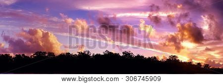 A Striking Brightly Coloured Orange Cumulonimbus Cloudy Tropical Panoramic Sunset Cloudscape Featuri