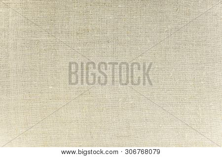 Sackcloth Or Burlap Background With Visible Texture. Closeup Of Light Natural Unpainted Fabric Of Ca