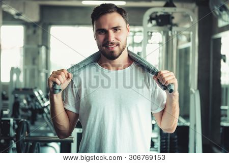 Portrait of Handsome Man is Exercising in Fitness Club.,Portrait of Strong Man Doing Working Out Calories Burning in Gym., Healthy and Fitness Exercise Lifestyle Concept.