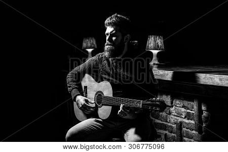 Play The Guitar. Beard Hipster Man Sitting In A Pub. Guitars And Strings. Bearded Man Playing Guitar
