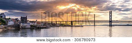 Panorama of beautiful sunset at The Forth road bridge and Queensferry crossing bridge in Edinburgh Scotland UK.