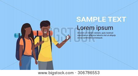 Couple Tourists Hikers With Backpacks Using Compass Searching Direction Hiking Concept Man Woman Afr