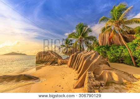 Anse Source Dargent At Sunset. Seychelles, La Digue. Landscape Of Palm Trees And Rock Stone Of Grani