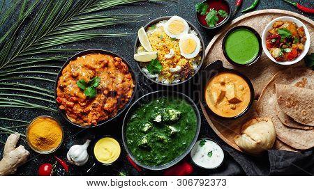 Indian Cuisine Dishes: Tikka Masala, Paneer, Samosa, Chapati, Chutney, Spices. Indian Food On Dark B