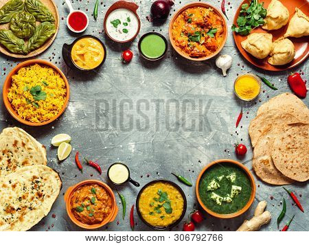 Indian Cuisine Dishes: Tikka Masala, Dal, Paneer, Samosa, Chapati, Chutney, Spices. Indian Food On G