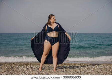 Attractive Busty Curvy Woman In A Blue Swimsuit Resting On The Beach. Stylish Accessories, Fashion F