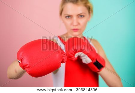 Concentrated On Punch. Woman Boxing Gloves Focused On Attack. Ambitious Girl Fight Boxing Gloves. Fe