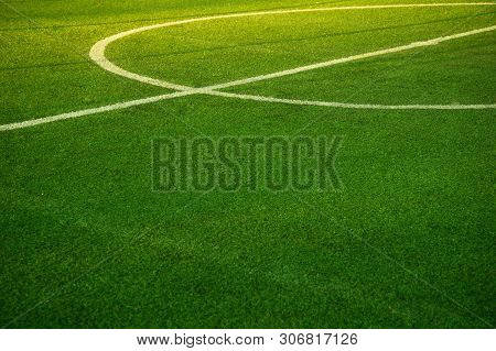 Sunlight On White Round Line Pitch Middle Of Green Grass Football Or Soccer Filed Sport Competition