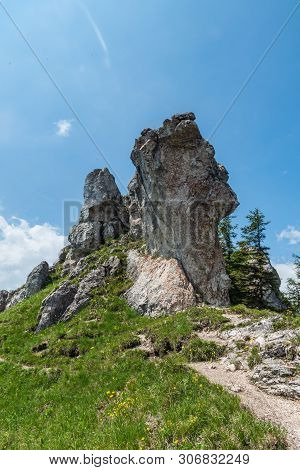 Limestone Rocks With Grass, Hiking Trail And Blue Sky On Ostra Hill In Springtime Velka Fatra Mounta