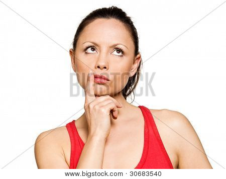 Portrait of expressive pensive cute woman looking up in studio isolated on white background
