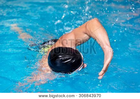 Swimming Pool Sport Crawl Swimmer. Man Doing Freestyle Stroke Technique In Water Pool Lane Training