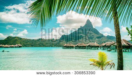 Bora Bora private island luxury vacation paradise beach background. Tahiti travel summer honeymoon destination.