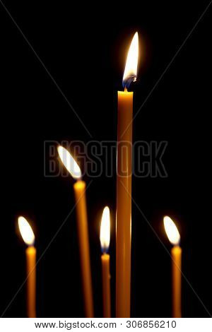 burning in the dark taper candles. the fire burning in the darkness poster