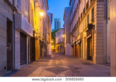 Empty Street And Aix Cathedral Or Cathedral Of The Holy Saviour Of Aix-en-provence At Night, Provenc