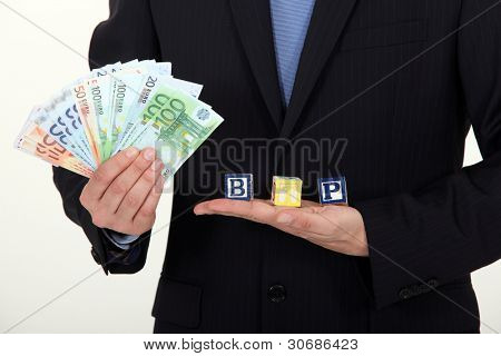 Banknotes and letter blocks