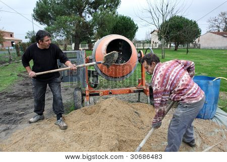 Laborers using a cement fixer