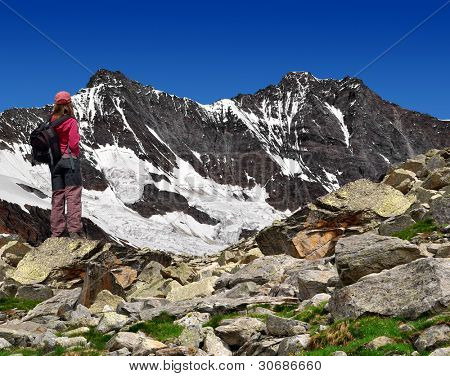girl looking at the beautiful Mount  Dom and Taschhorn - Swiss alps
