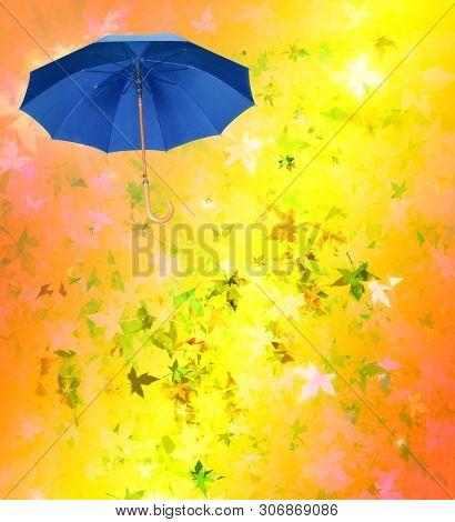 Blue Umbrella On Yellow Defocused Autumn Background. Weather Concept.