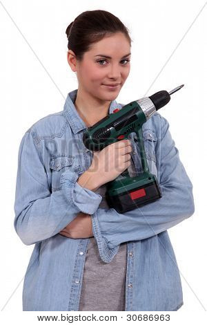 Woman with cordless drill