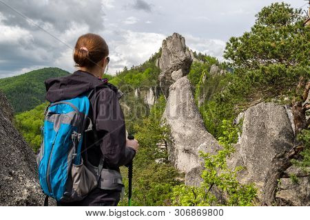 Hiker Woman With Backpack Looking At Sulov Rocks, Slovakia