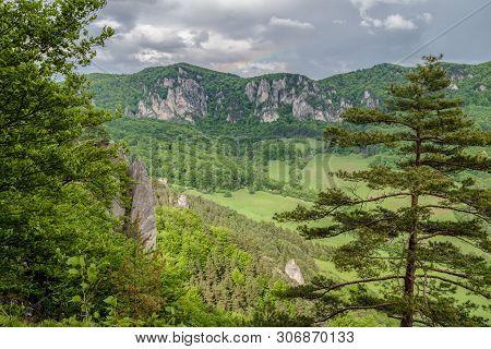 Small Rainbow Over Sulov Rocks, Slovakia. Summer Landscape