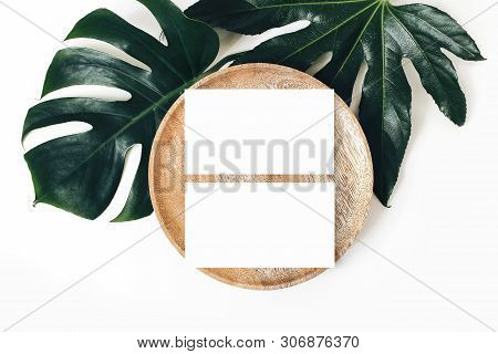 Blank White Business Cards Mockups, Wooden Plate, Aralia And Monstera Leaf Isolated On White Table B