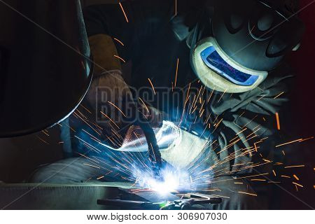 Welder, Craftsman, Erecting Technical Steel Industrial Steel Welder In Factory