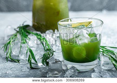 Estragon Lemonade. Concept Refreshing Summer Drinks. Fresh Cool Lemonade Tarragon With Ice And Citru