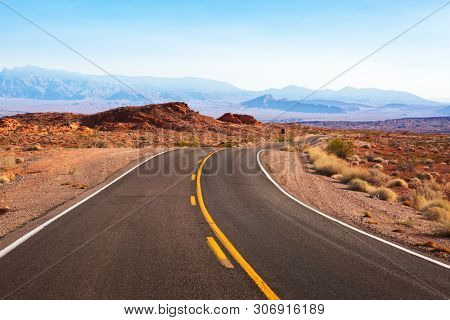 Winding road  through the desert landscape. White Domes Road (Mouse's Tank Road), Nevada, United States.
