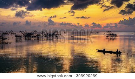 Scene Of Beautiful Sunrise In The Morning And Giant Square Dipnet At Pakpra Village, Phatthalung, Th