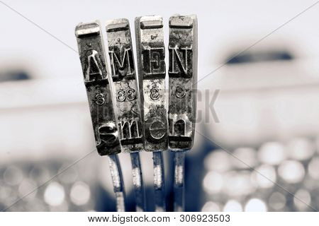 The word AMEN  with old typewriter  in monochrome